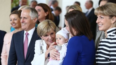 Happier times ... Kelly O'Dwyer and daughter Olivia joined the women in the ministry in a photo with then Prime Minister Malcolm Turnbull and his deputy, Julie Bishop, after the swearing-in ceremony in 2015.