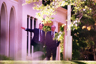 Camping out: Paul Keating shows prime minister-elect John Howard around The Lodge in 1996. Howard decided it wasn't for him, breaching tradition.