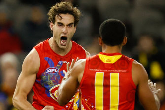 Ben King fires up for the Suns, with Touk Miller.