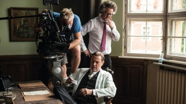Florian Henckel von Donnersmarck (rear, right) directs Sebastian Koch (sitting) in a scene from Never Look Away.