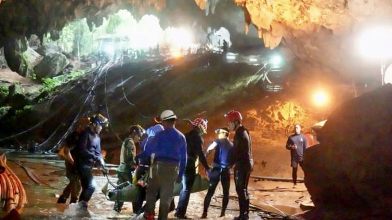 One of the boys is stretchered out of the Tham Luang cave, an expansive cave network that will now be turned into a museum.