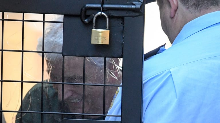 Gold Coast businessman Michael Issakidis being escorted to a prison van in 2017.