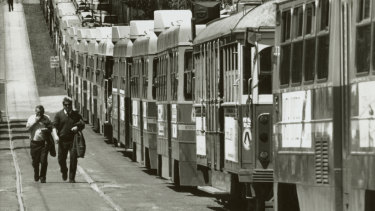 Trams line up during the long-running dispute about the removal of conductors from Melbourne trams in 1990.