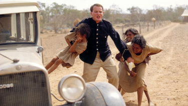 A scene from the movie Rabbit-Proof Fence when the three girls are grabbed.