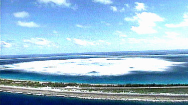 The sea close to the shore of Fangataufa Atoll turns white following the detonation of an underground French nuclear test.