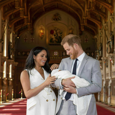 The Duke and Duchess of Sussex with newborn son Archie in St George's Hall at Windsor Castle.