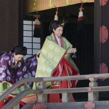 Empress Masako on her way to report the date of her husband's enthronement ceremony  to the imperial ancestors in May.