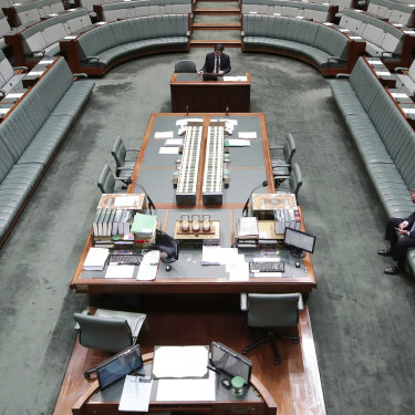 Christopher Pyne on his phone in the House of Representatives on August 23, 2018.