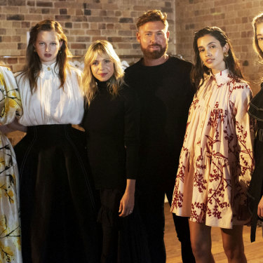 Fashion designers Edwina Forrest and Adrian Norris (in black, centre) of  fashion label Aje.