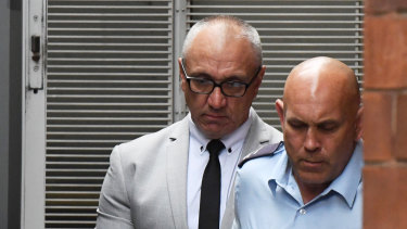 Michael Meakin (left) is taken from the NSW Supreme Court in Sydney on Friday.