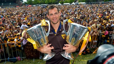 Glory days: Former Hawthorn captain Luke Hodge with the 2014 and 2013 Premiership trophies at Glenferrie oval in Melbourne.