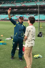 Riley receives from tips from Australia coach Justin Langer.