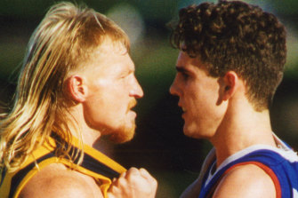 Wayne Weidemann gets acquainted with Bulldogs player (and now GWS coach) Leon Cameron in 1994.