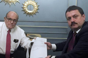Rudy Giuliani, pictured with Ukrainian official Andriy Derkach, who has been named as part of a Russia disinformation effort.
