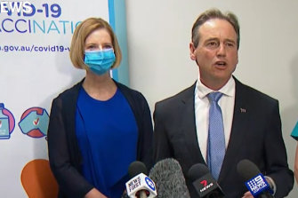 Federal Health Minister Greg Hunt with former prime minister Julia Gillard (left) at a press conference on Sunday after the pair received the AstraZeneca vaccine.
