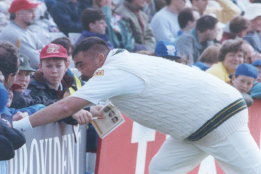 Merv Hughes gets familiar with the crowd at Old Trafford in 1993.