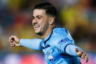 Marco Tilio celebrates the late goal that put Sydney 2-0 up over the Mariners.