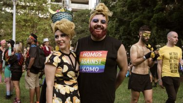 Polly Henry and Julian Olsen among the revellers at the Sydney Gay and Lesbian Mardi Gras.