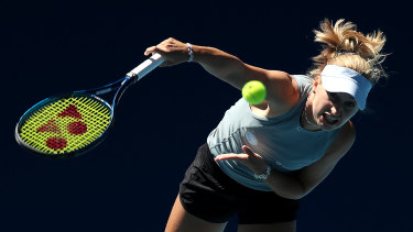 Daria Gavrilova serves against Viktoria Kuzmova of Slovakia.