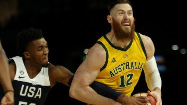Australia's Aron Baynes grapples with Donovan Mitchell of the US on Saturday.