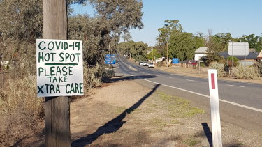 """A handmade sign warns road users that Broken Hill has become a """"hotspot"""" for the coronavirus."""