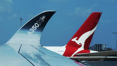 Pilots have approved a crucial wage deal, but Qantas has deferred ordering new aircraft for Project Sunrise.