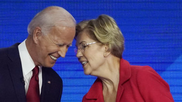 Democratic presidential contenders Joe Biden and Elizabeth Warren speak on stage in Houston at the Democratic debate.