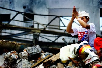 A Balinese man prays over the rubble of the Sari Club in November 2002. The idea of the Ubud Writers and Readers Festival was a repudiation of that year's terrorist attacks on the island.