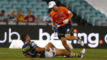Man down: Jarryd Hayne receives medical before leaving the field against the Sharks at ANZ Stadium.