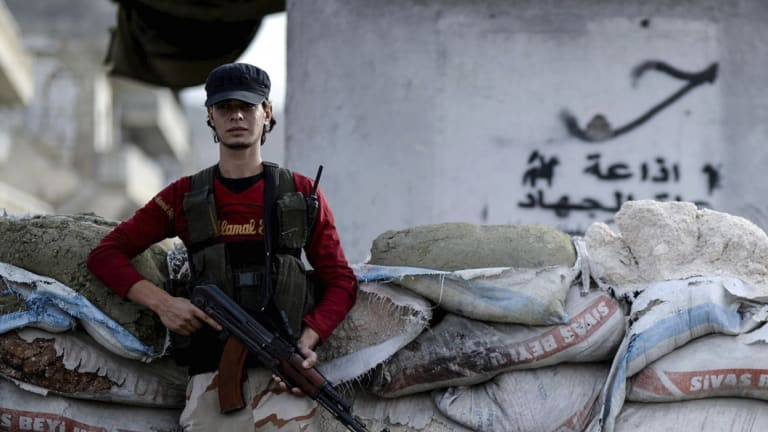 A Syrian opposition fighter stands at a checkpoint in the north-western city of Idlib, Syria, in October.