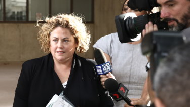 Rosemary Rogers leaving Surry Hills police station on bail.