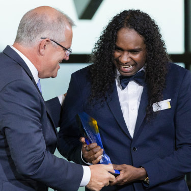 Danzal Baker receives his Young Australian of the Year award from Prime Minister Scott Morrison.