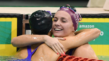 Ariarne Titmus hugs Emma McKeon after the 200m freestyle.