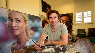 Artist Vincent Fantauzzo with a painting of his wife, Asher Keddie.