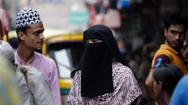 An Indian Muslim woman at a market in New Delhi.