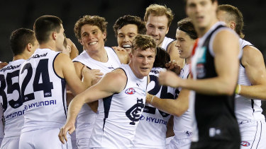 Charlie Curnow (centre) was all smiles in his return to action with the Blues.