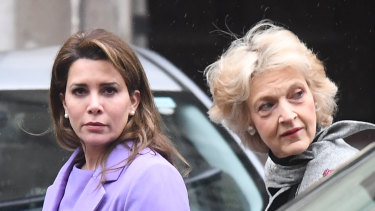 Princess Haya, left, arrives with her lawyer Baroness Fiona Shackleton at the High Court in London, England.