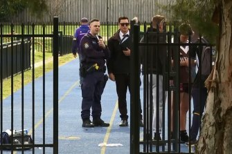 Police at the Old Saleyards Reserve in North Parramatta, where the match was played, on Sunday.