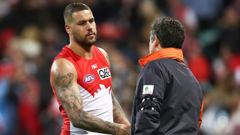 Lance Franklin shakes hands with Giants coach Leon Cameron after the Swans' defeat.