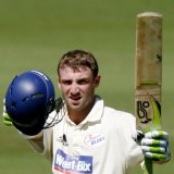 The late Phillip Hughes celebrates scoring a century for NSW in 2009.