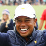 American captain Tiger Woods celebrates after clinching the Presidents Cup on Sunday.