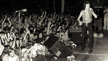 Bon Scott on stage with the band at the Hordern Pavilion in Sydney on December 12, 1976.