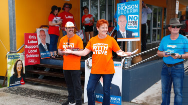 One Nation leader Senator Pauline Hanson hands out how to vote cards at the polling booth set up at Mountain Creek State School in Buderim, during the 2017 state election.