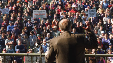 Former PM John Howard, wearing a bullet-proof vest, addresses gun owners in Sale following the Port Arthur massacre.