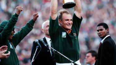 Springboks captain Francois Pienaar lifts the William Webb Ellis trophy at Ellis Park after the 1995 World Cup final.