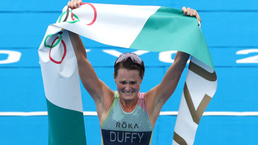 Solid gold: Triathlete Flora Duffy celebrates becoming Bermuda's first ever Olympic champion.