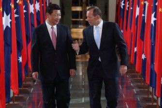 Chinese President Xi Jinping, left, and then prime minister Tony Abbott at Parliament House in Canberra in 2014.