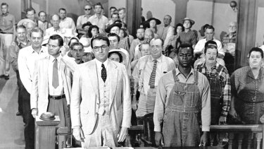 Gregory Peck, foreground left, and Brock Peters, foreground right, in a scene from the 1962 film <i>To Kill a Mockingbird</i>.