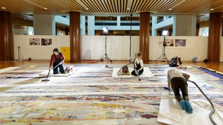 Conservation and heritage students at the University of Canberra got hands-on experience vacuuming the sprawling tapestry.