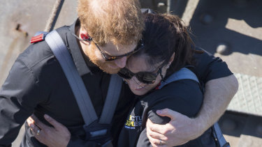 Prince Harry with fellow Harbour Bridge climber Gwen Cherne, the widow of a military veteran who took his own life.